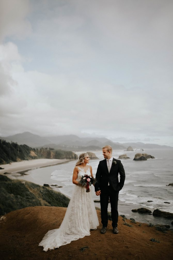 Newlyweds on cliff top | Real Wedding Janay and Jono