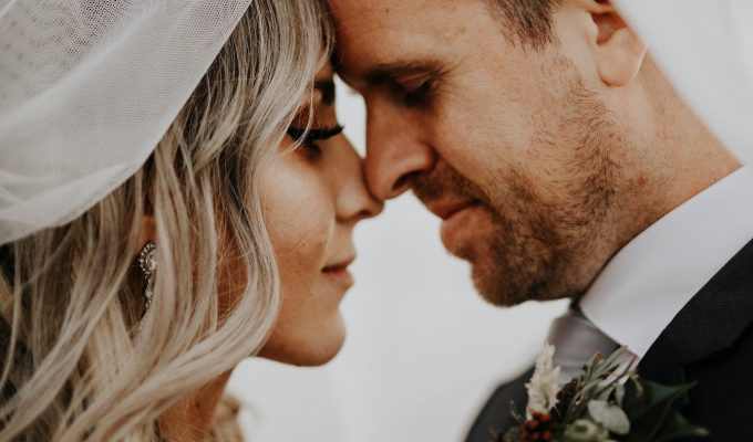 Couple underneath veil | Real Wedding Janay and Jono