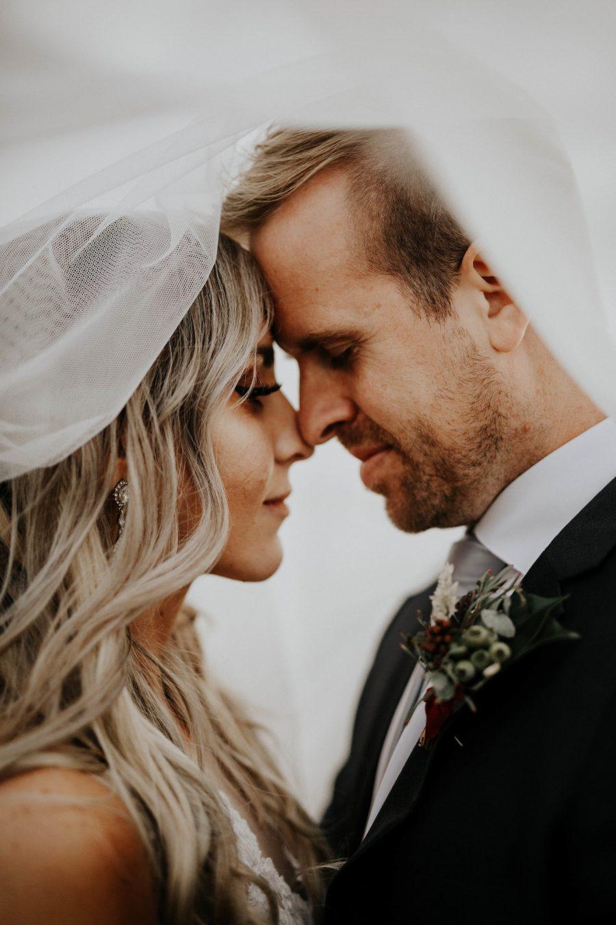 Couple underneath veil | Real Wedding Janay and Jono
