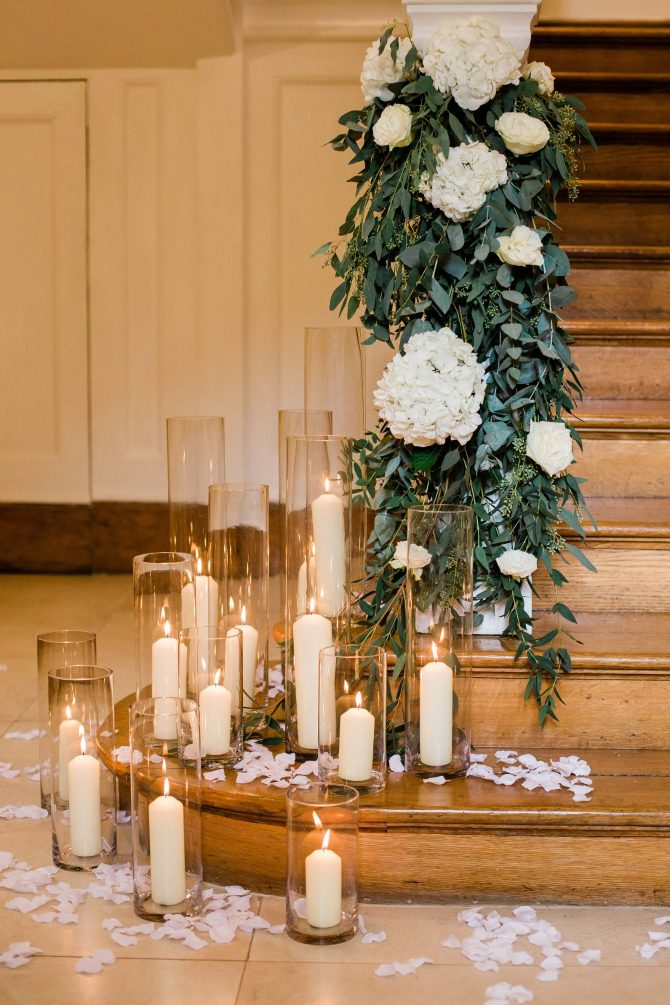 Wedding flowers and candles on staircase