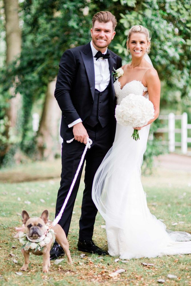 Wedding couple with French Bulldog