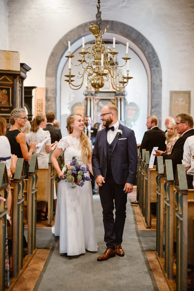 Bride and groom walking down aisle | Real Wedding Mari and Tarjei at Båtsportens Hus