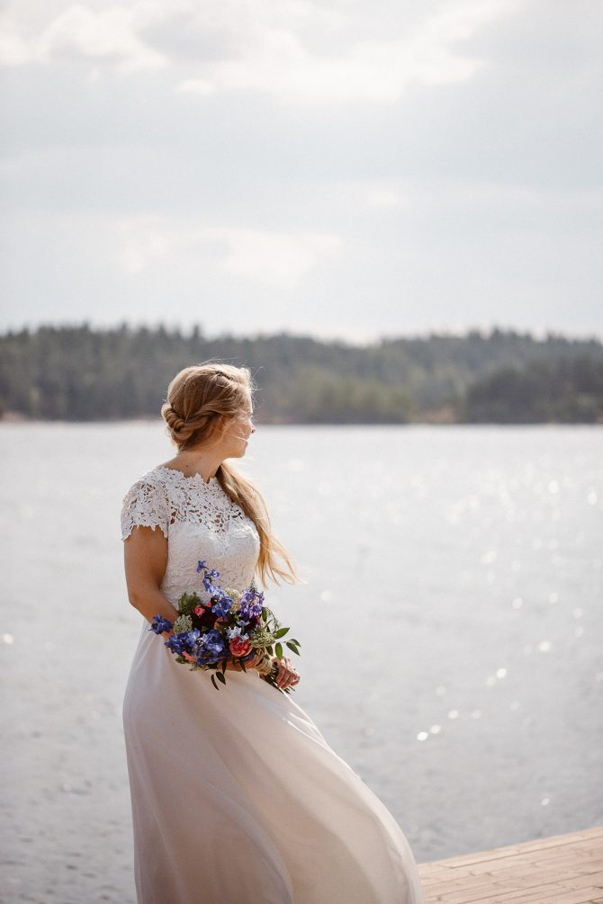Bride on shoreline | Real Wedding Mari and Tarjei at Båtsportens Hus